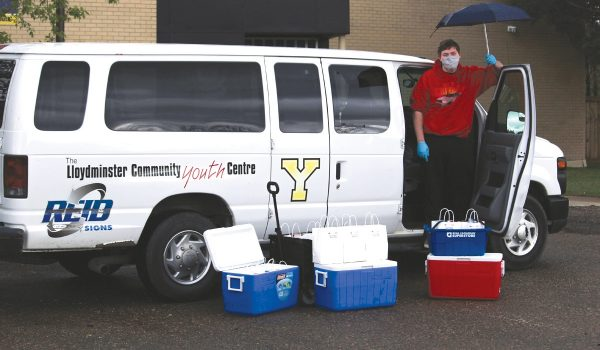 Youth involved in this year's Dinner Thyme curbside food deliveries gained confidence, skill and pride helping families according to a project update. Photo submitted